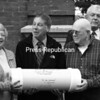 Shown before burying the Moriah Time Capsule are (from left) Joan Daby, Richard Carpenter, Archie Rosenquist and Thomas Scozzafava. The capsule will be dug up and opened in 2108.<br><br>(Staff Photo/Lohr McKinstry)