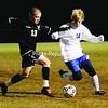 Plattsburgh High School's Drew Wyand (13) and AuSable Valley's Jordan Holdridge (14) contest the ball during Class B boys' soccer final Thursday night in Chazy. PHS won 2-0.<br><br>(P-R Photo/Michael Betts)