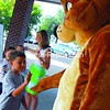 Second-grade students at Bailey Avenue School in Plattsburgh are directed by Principal Diane Thompson as they give their mascot, Buddy Bear, a high five after learning about school safety. Thompson and Buddy Bear demonstrated to the students the proper way to enter the school, cross streets and safely wait for their ride at the end of the day.<br><br>(P-R Photo/Rachel Moore)