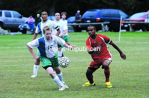 Sean Bacon (10) of Seton Catholic and Braxton Raymond (12) of Beekmantown turn to make a play on the ball during their Champlain Valley Athletic Conference boys' soccer game Monday afternoon.  The Eagles defeated the Knights 2-0.<br><br>(P-R Photo/Kelli Catana)