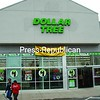 Customers leave the Dollar Tree store at Champlain Centre South during its grand opening in its new location.<br><br>(P-R Photo/Bruce Rowland)