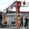 Workers from Fuller Excavating demolish the Kentucky Fried Chicken building in Plattsburgh. When rebuilt, the new layout is expected to improve traffic flow around the Cornelia Street property and upgrade the restaurant, including the addition of a fireplace and flat-screen TV.<br><br>(Staff Photo/Kelli Catana)