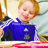 Owen Mulligan, 4, of Plattsburgh smiles as he dives in for another mouthful of syrup-drenched pancakes at the 39th-annual Sanger's Sugar House Pancake Breakfast in the Chazy hamlet of Ingraham Sunday. The annual open house and breakfast, hosted by Sanger's, was served by and benefited North Country Squares. More photos on Page A3.<br><br>(P-R Photo/Rachel Moore)