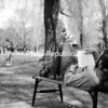 "Dan O'Brien, an English major at Plattsburgh State, enjoys the sunshine as he reads ""The Master and Margarita"" by Mikhail Bulgakov near Hawkins Hall pond.<br><br>(Staff Photo/Kelli Catana)"