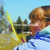 Ava Mars, 2, of Morrisonville has fun with a bubble wand while playing outside in Plattsburgh. The mild weather the past few days drew many outdoors. It will be cooler today, but the sun will be shining.<br><br>(P-R Photo/Rachel Moore)