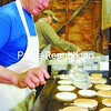 Leo Drinkwine flips a pancake as he works to feed a morning rush of people. More than 550 pounds of pancake mix and 42 gallons of maple syrup were used over the weekend.<br><br>(P-R Photo/Rachel Moore)