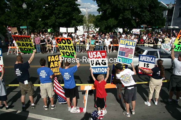 Members of Pastor Fred Phelps's Westboro Baptist Church picket against gays and America on Margaret Street across from Trinity Park in Plattsburgh July 2.The Trinity Park action drew the largest and loudest crowd of anti-protesters as several of them tried to shout down the Phelps crew.<br><br>(P-R File Photo/Michael Betts)