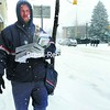 Mail carrier Shawn Poupore walks his snowy route through downtown Plattsburgh Wednesday.<br><br>(Staff Photo/Kelli Catana)