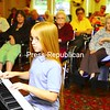 Nine-year-old Justin Wise of Morrisonville plays the piano for the residents of Meadowbrook Health Care in Plattsburgh. He enjoys performing classical pieces by Beethoven and other composers.<br><br>(Staff Photo/Kelli Catana)