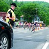Essex County Deputy James Bigelow kept a wary eye on incoming bikes during Lake Placid Ironman Sunday. His post, staging traffic through the three-way intersection in Keene, was among the most challenging in the 112-mile bike race.<br><br>(Staff Photo/Kim Smith Dedam )