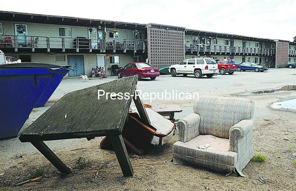 Garbage and discarded furniture litter the parking lot of Lakeside Apartments in Plattsburgh.<br><br>(P-R Photo/Michael Betts)