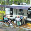 George and Betty Bombard of AuSable Forks enjoy some sunny weather outside their camper Sunday evening at the Cumberland Bay State Park. This season has included plenty of rainy days too. Local campgrounds say that although the rain has hindered business some, it's still a good season overall.<br><br>(P-R Photo/Meagan Murray)