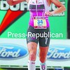 Tereza Marcel raises an arm in celebration as she approaches the end of the 2009 Ironman Lake Placid Triathlon Sunday. Macel, who represents the Czech Republic, but lives in Canada, was the first pro woman to finish the race.<br><br>(P-R Photo/Rachel Moore)