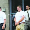 Franklyn Akey is escorted out of the City Police Station Tuesday.<br><br>(Staff Photo/Kelli Catana)
