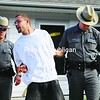 Taylor Kilfoyle, 26, of Plattsburgh is escorted from the state police barracks. Kilfoyle was arrested along with Steven Burleigh and Lisa Joy and the three are being charged with second-degree burglary for the recent break-in on Miner Farm Road in West Chazy.<br><br>(Staff Photo/Kelli Catana)