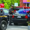 Law-enforcement officers process a green Volkswagon Jetta, that is an item of interest in the investigation of Lisa Joy, Steven Burleigh and Taylor Kilfoyle, at Buck's Discount on Route 22.<br><br>(Staff Photo/Kelli Catana)