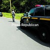 State Police line Haynes Road in Beekmantown Thursday morning, searching for two men who allegedly tried to break into a vacant home. Teenagers had chased the suspects after spotting them crouching by a window. State Police are still investigating the incident.<br><br>(P-R Photo/Michael Betts)