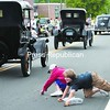Youngsters reach for treats at the E'Town Day parade Saturday. The festivities began with a block party Friday night. Weekend events included town-wide yard sales, games and a presentation at the Adirondack History Museum about how Elizabethtown used to look . <br><br>(Staff Photo/Alvin Reiner)