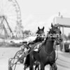 Burgess Express, driven by Clyde Burgess Jr. from Bennington Vt., and Famous Oscar, driven by Nelson Haley of Shrewsbery, Vt.,warm up for harness races Tuesday at the Clinton County Fair. Today's races begin at noon.<br><br>(Staff Photo/Kelli Catana)
