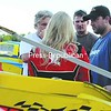 NASCAR Sprint Cup leader Tony Stewart (right) talks with rising Sprint Cup star Jessica Zemken (back to the camera), Airborne Speedway promoter Mike Perrotte (left) and an unidentified individual Saturday night at Airborne. Stewart, who will be racing at New Hampshire Speedway in Loudon today, visited the South Plattsburgh track to watch Zemken, who finished 12th in the modified feature Saturday night. Stewart spent about 2 hours in the pit area. See Airborne, NASCAR stories, other photos, Page B3.<br><br>(P-R Photo/Michael Betts)