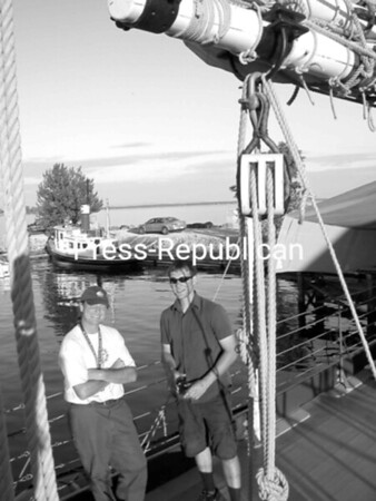 Zak Smith (right) of Rouses Point discusses all things nautical with Erick Tchonuk, first mate on the Lois McClure. The full-scale replica of an 1862-class sailing canal boat, from the Lake Champlain Maritime Museum, was docked at Gaines Marina in Rouses Point for two days as part of the Town of Champlain's Lake Champlain Quadricentennial activities. In conjunction, the Rouses Point-Champlain Historical Society hosted a wine and cheese party. The next event on the schedule is the Point au Fer Racing Club/Samuel de Champlain Cup sailboat race, which begins at the breakwater near Stony Point in Rouses Point at 10 a.m. Saturday.<br><br>(Staff Photo/Suzanne Moore)