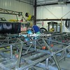 A welder assembles one of the large trackers that supports and controls the solar panels.<br><br>(P-R Photo/Bruce Rowland)