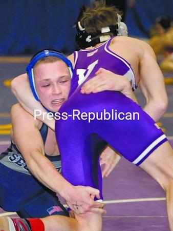 Arik Robinson (facing camera) battles Austin Keough (Section V) at 103 pounds. Robinson won 2-1 to advance. <br><br>(P-R Photo/Mike Okoniewski)