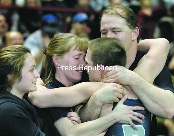 Peru's Arik Robinson receives hugs from family members as he celebrates his second state wrestling title Saturday. From left are sister Samatha, mom Tina and father Chad Robinson. <br><br>(P-R Photo/Mike Okoniewski)
