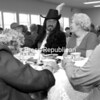 David Graham portrays Samuel de Champlain as he visits with a table of guests at the seventh annual High Tea with Famous People at the Peru Community Church. The Psi Chapter of the Delta Kappa Gamma Society, a professional honor society of women educators, sponsored the event that featured conversation with 10 famous people in history, tea and light refreshments. Additional photos from this event can be viewed in the galleries at www.pressrepublican.com.<br><br>(P-R Photo/Rachel Moore)