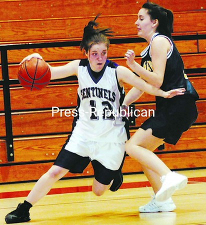 Ticonderoga's Sam Diehl (12) tries to drive past a Lake Placid  defender during Friday's Section VII Class C girls' semifinal. Ticonderoga won 41-26. See stories, Page B4. Bonus photos available at www.pressrepublican.com.<br><br>(P-R Photo/Michael Betts)
