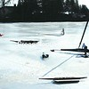 Scooter enthusiasts work on their ice craft on Young's Bay in Westport.<br><br>(Staff Photo/Alvin Reiner)