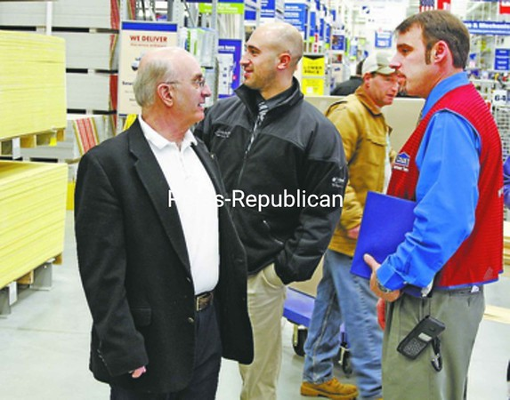 Attending the preview opening of the Ticonderoga Lowe's Friday are Town Supervisor Robert C. Dedrick (left) and Ticonderoga Area Chamber of Commerce Executive Director Joseph Conway (center), talking with Assistant Manager Jason Joiner.<br><br>(Staff Photo/Lohr McKinstry)