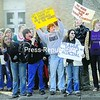 Plattsburgh High School students protest Friday morning in front of the Duken administration building on Broad Street. The students were upset with the City School Board's decision not to grant tenure to PHS Principal John Fairchild.<br><br>(Staff Photo/Kelli Catana)