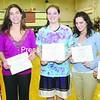 The CVAC Second Team for girls' basketball includes, from left to right: Zoe Saulsgiver, AuSable Valley; Alex King, Peru; Julie Thompson, Ticonderoga; Meagan McComb, Northeastern Clinton and Megan Bowman, Saranac.<br><br>(P-R Photo/Michael Betts)