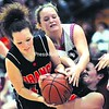 Indian Lake/Long Lake's Melanie Pierson (left) and Carli Reynolds (right) look to grab a loose ball from Willsboro's Codia Holland (center). The Warriors defeated the Orange in the second Section VII Class D semifinal game 44-39 at the Plattsburgh State Field House Tuesday. Bonus photos from this game will be available at midday on pressrepublicanphotos.com.<br><br>(P-R Photo/Michael Betts)