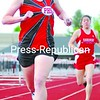 Plattsburgh High's Hillary Miller leads the first leg of the girls' 3,200-meter relay with Saranac's Katelyn Facteau in pursuit. PHS won the event, but Saranac took the meet. <br><br>(P-R Photo/Rachel Moore)