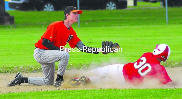 Plattsburgh High second baseman Brett Gilman gets set to apply the tag as Saranac's Devon Klooster is out trying for a double in CVAC baseball action Tuesday at Lefty Wilson Field. PHS won 4-3. Bonus pictures will be available at pressrepublicanphotos.com by midday.<br><br>(P-R Photo/Rachel Moore)