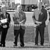 Essex County Clerk Joseph Provoncha (left) reads the invocation Tuesday as members of the County Board of Supervisors gather outside the county complex for a day-after-Memorial Day ceremony. From left are Supervisors Joyce Morency, Robert C. Dedrick, David Blades, Randy Douglas and William Ferebee. The supervisors were attending a Ways and Means meeting in Elizabethtown.<br><br>(Staff Photo/Lohr McKinstry)