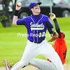 Ticonderoga shortstop Robert Kearns (12) retires Plattsburgh High School runner David Latulipe (14) at second base and relays the ball to first to complete a double play in the Sentinels' 9-7 win at Lefty Wilson Field Wednesday.<br><br>(P-R Photo/Michael Betts)