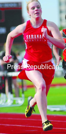 Saranac's Tiffany Helms is on her way to a sweep of the sprints Tuesday. She won the 100, 200 and also ran with the winning 400-meter relay team. Bonus photos will be available at pressrepublicanphotos.com at midday.<br><br>(P-R Photo/Rachel Moore)