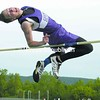 Ticonderoga's Dustin Scott flies over the bar to win the high jump Tuesday in CVAC track & field action against EKMW.<br><br>(Staff Photo/Alvin Reiner)
