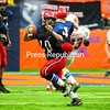 Moriah quarterback Nate Gilbo scrambles for a 6-yard gain during the second quarter of the state Class D football championship game Saturday in Syracuse.<br><br>(P-R Photo/Richard Mossotti)