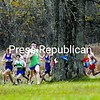 Seton Catholic's Michael Champagne leads the field around the first turn at Point au Roche State Park Tuesday in CVAC cross-country competition with Beekmantown and Ticonderoga. Champagne set a course record with a blistering 14:24 time. Beekmantown won the meet to cap a perfect season. Bonus photos of this meet will be available at pressrepublicanphotos.com by midday.<br><br>(P-R Photo/Michael Betts)