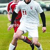 Beekmantown's Malo Valerian (21) protects the ball from Saranac Lake defender Wyatt Daviau in Section VII Class B soccer playoff game Thursday in Beekmantown. Beekmantown won 5-1 with Valerian getting a goal.<br><br>(P-R Photo/Michael Betts)