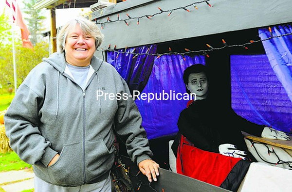 """Anna Burl has decorated her home at 199 Bradford Road in the Town of Plattsburgh for Halloween for more than 20 years. Every year, she adds to her collection of decorations. This year, a new hearse and driver, made by her son Timothy Burl of Peru, is featured. Starting in the second week of October, all the handmade decorations come out of crates and into the yard. """"I do it for the kids,"""" Burl said. Check out area Halloween events in today's Community Calendar, Page A8.<br><br>(Staff Photo/Kelli Catana)"""