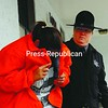 Kathryn Shoemaker ducks from the media after an appearance Thursday in Plattsburgh Town Court. She is charged with the murder of Ravin Miller.<br><br>(Staff Photo/Kelli Catana)