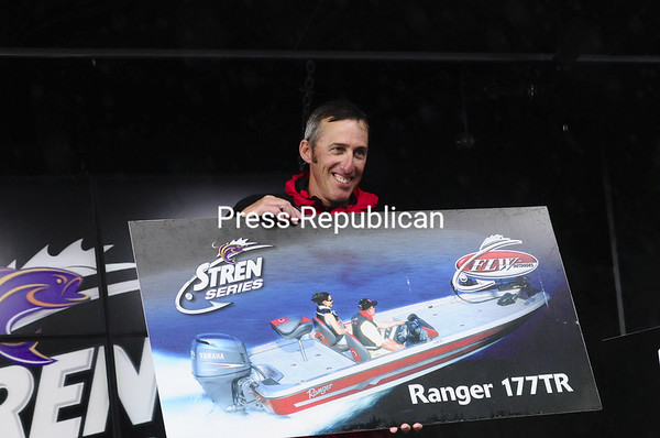 Tony Bushey of Champlain holds up a picture of the Ranger 177TR boat he earned for winning the Co-Angler Division of the Stren Series Northern Division bass tournament on Lake Champlain Saturday. Bushey also won a trailer.<br><br>(P-R Photo/Michael Betts)