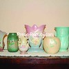 During the '30s and '40s, Ohio art pottery was considered ideal for gift giving and special occasions. It could be found in fine department stores for a few dollars, but today command values in the hundreds. This photo features molded floral vases by Roseville, Weller, Hull and McCoy. <br><br>(P-R Photo/Julie Robinson Robards)