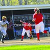 Plattsburgh State third baseman Diana Garces fields a bunt as first baseman Ashley Napear (24) runs in and Brockport's Nikki Odrobina (2) takes off for first. The Golden Eagles won the first game, and the Cardinals took the second.<br><br>(Staff Photo/Kelli Catana)