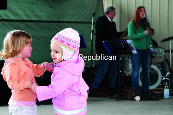 Abigail Henley (left), 2, and Taylor Durney, 2, both of Plattsburgh, dance together to the tunes of the Natalie Ward Band Saturday afternoon at the Plattsburgh Farmers and Crafters Market.<br><br>(P-R Photo/Gabe Dickens)